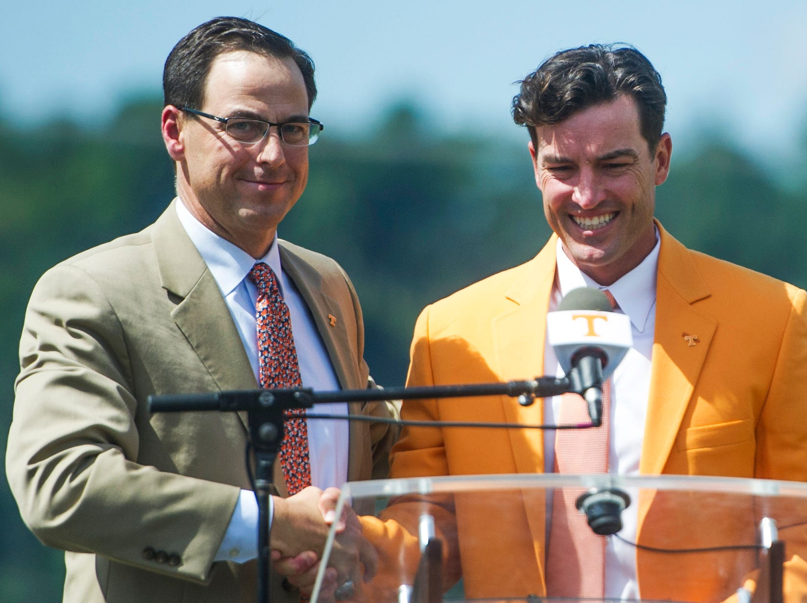 At left John Currie, Tennessee vice chancellor and director of athletics shakes new University of Tennessee Baseball Head Coach Tony Vitello's hand at a press conference introducing him to the media, at Lindsey Nelson Stadium on Friday June 9, 2017.
