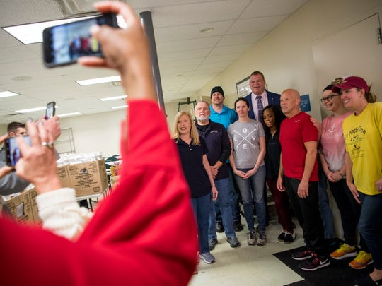 Knox County Mayor Glenn Jacobs takes a photo with volunteers at The Love Kitchen on Thursday, February 14, 2019.