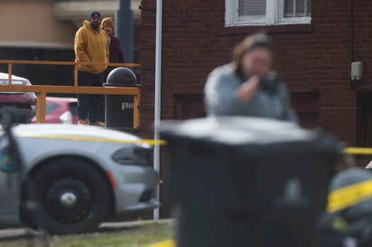 People watch as the the Knoxville Police Department investigates a shooting near the Pilot gas station on East Magnolia in East Knoxville, Thursday, Feb. 14, 2019. One man was shot and the suspect is in custody.