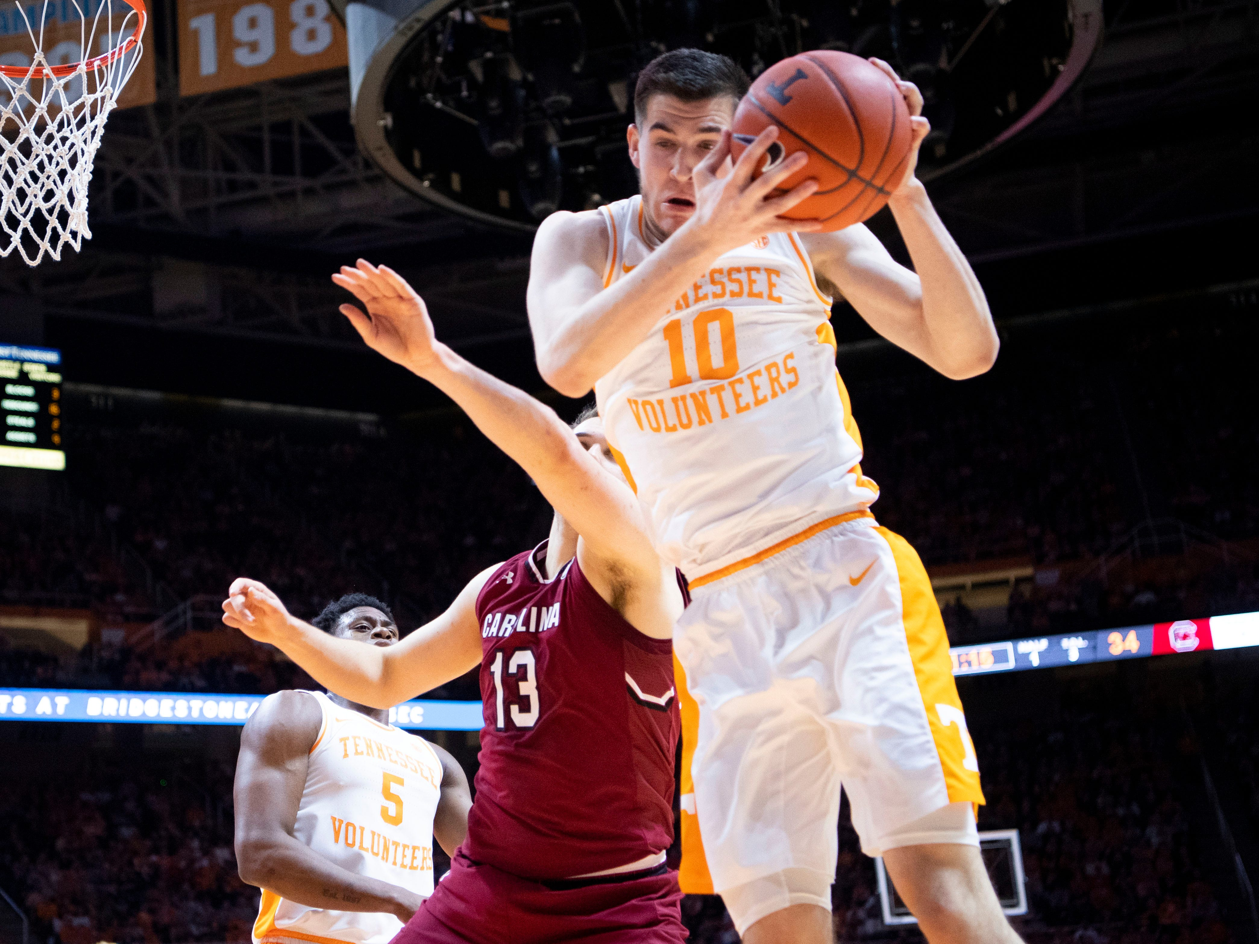 Tennessee's John Fulkerson (10) gets the rebound over South Carolina's Felipe Haase (13) on Wednesday, February 13, 2019.