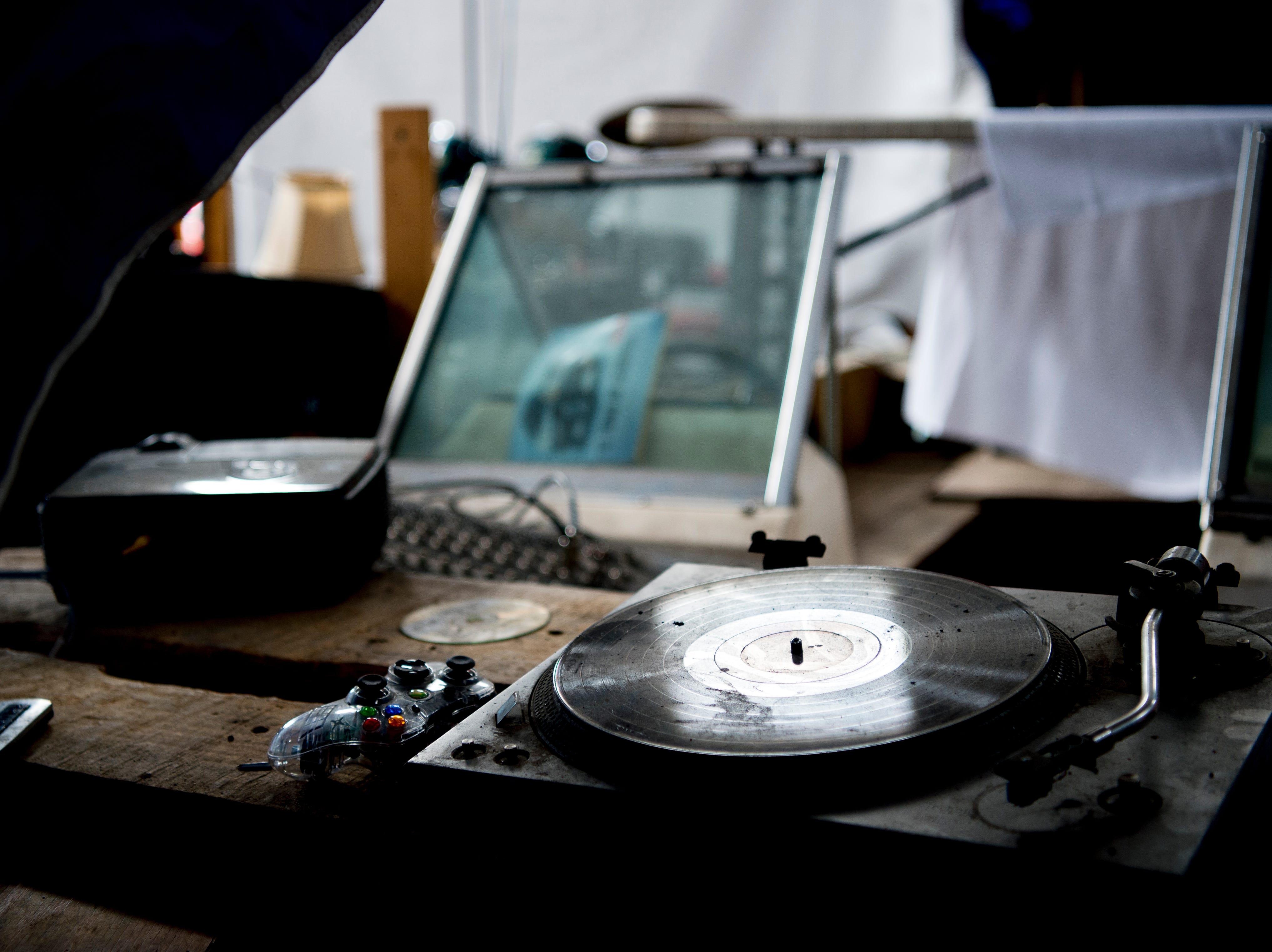 An old turntable sits on a boat in the center of the venue at Bar Marley in Knoxville, Tennessee on Thursday, February 14, 2019. The Caribbean-themed Bar Marley is facing possible acquisition and condemnation by KCDC due to code violations.