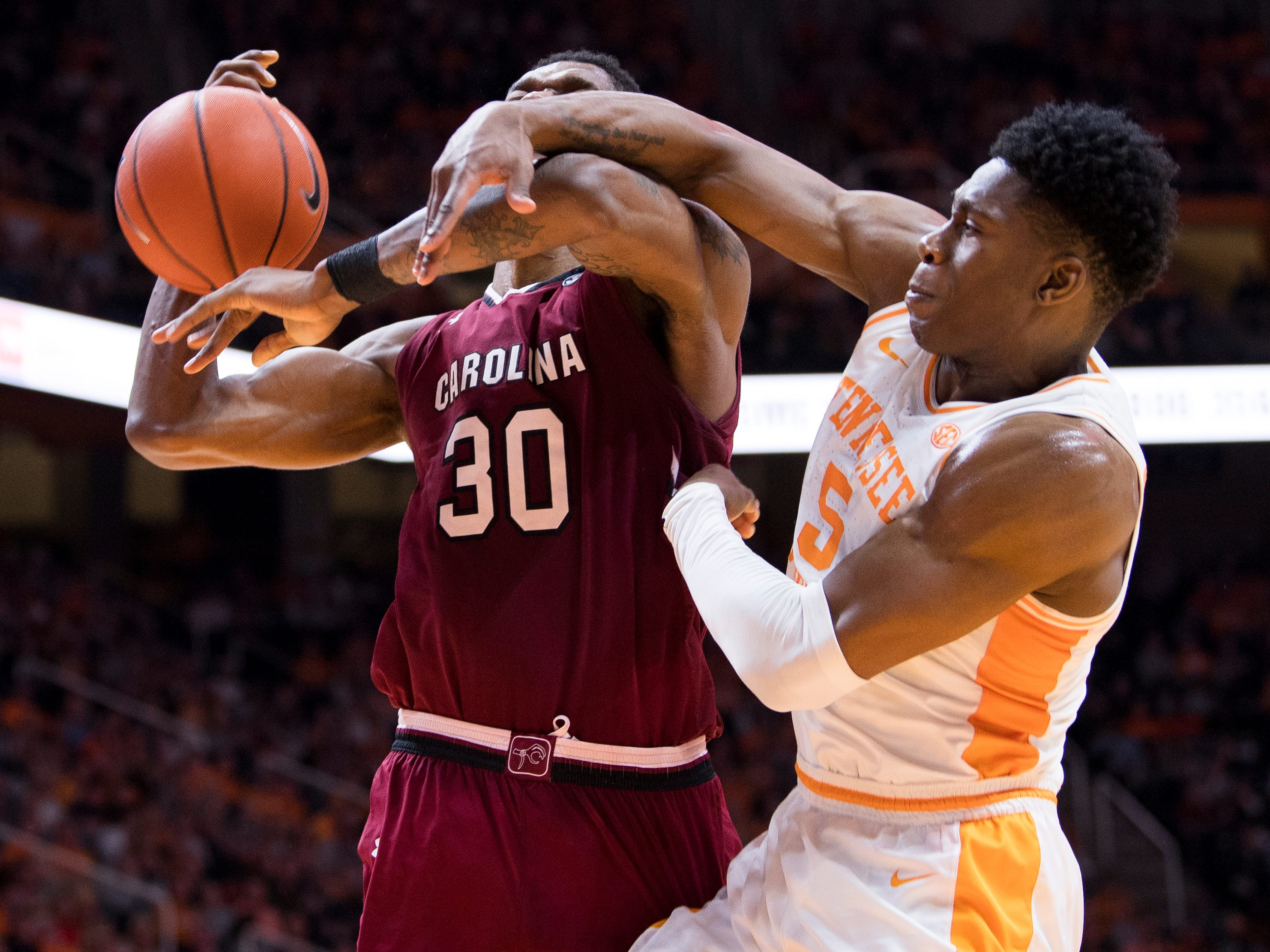 Tennessee guard Admiral Schofield (5) fouls South Carolina forward Chris Silva (30) during Tennessee's home SEC game against South Carolina at Thompson-Boling Arena in Knoxville on Wednesday, February 13, 2019.