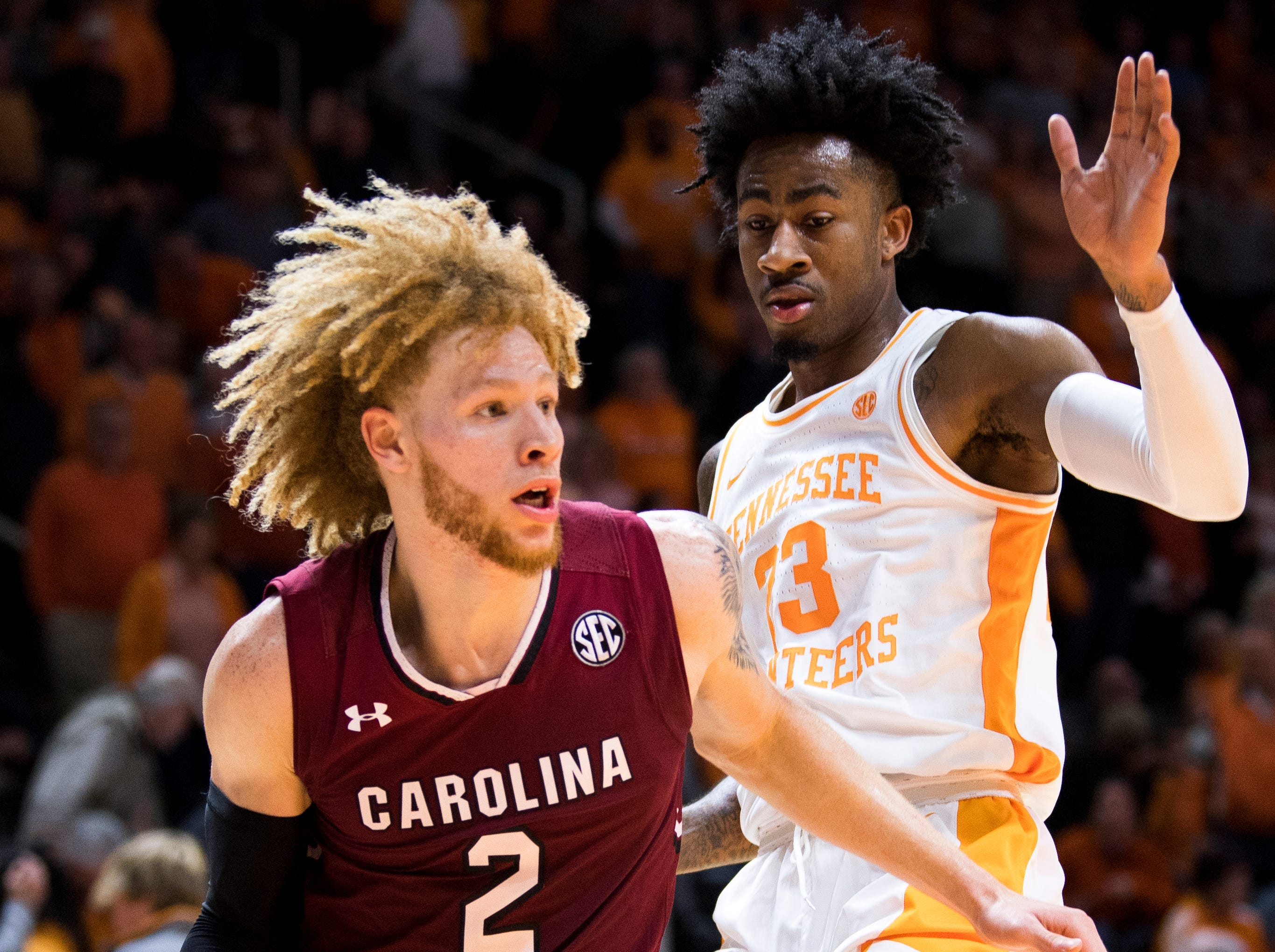 Tennessee guard Jordan Bowden (23) defends South Carolina guard Hassani Gravett (2) during Tennessee's home SEC game against South Carolina at Thompson-Boling Arena in Knoxville on Wednesday, February 13, 2019.