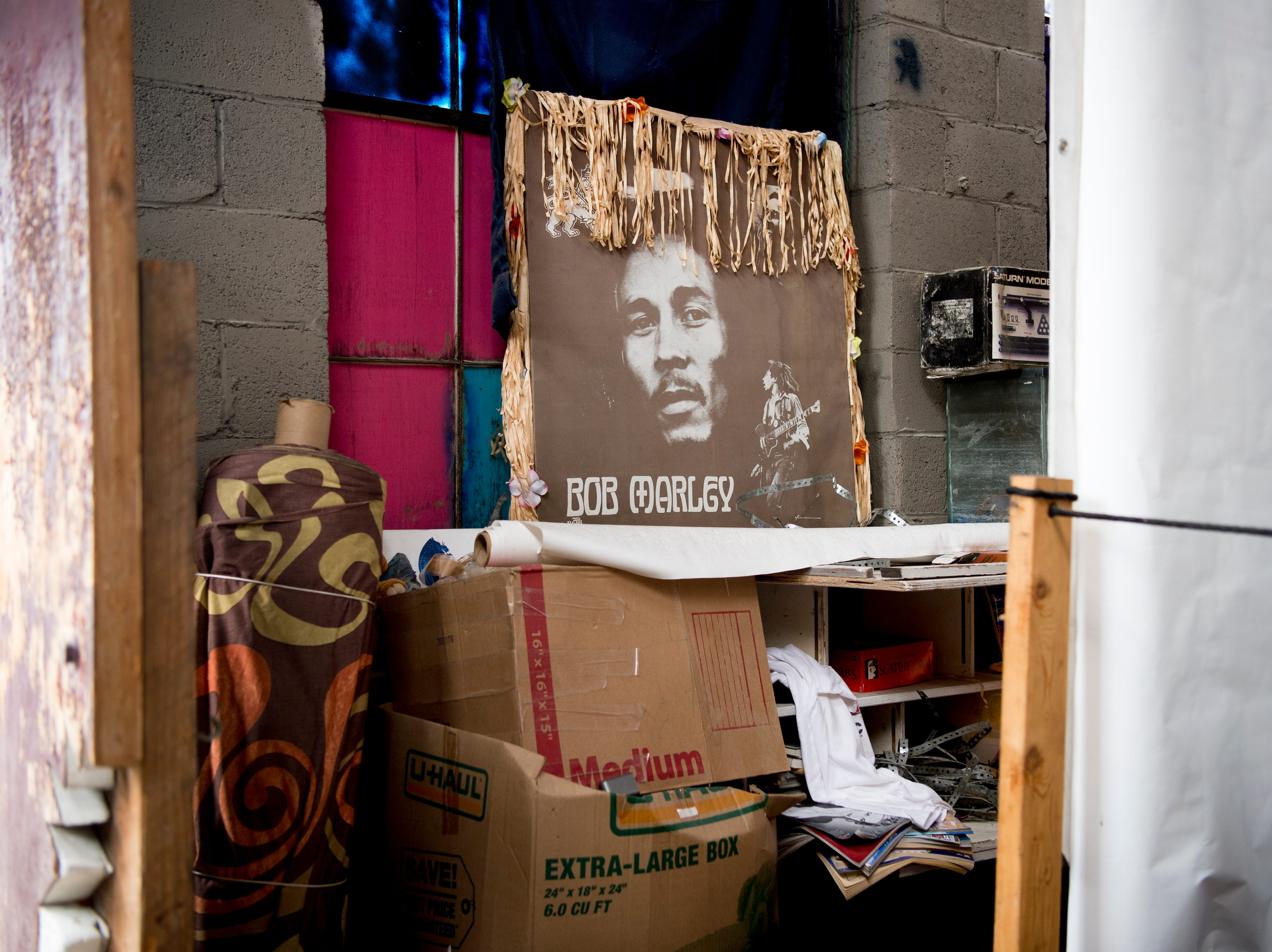 A poster of musical artist Bob Marley sits on a windowsill at Bar Marley in Knoxville, Tennessee on Thursday, February 14, 2019. The Caribbean-themed Bar Marley is facing possible acquisition and condemnation by KCDC due to code violations.