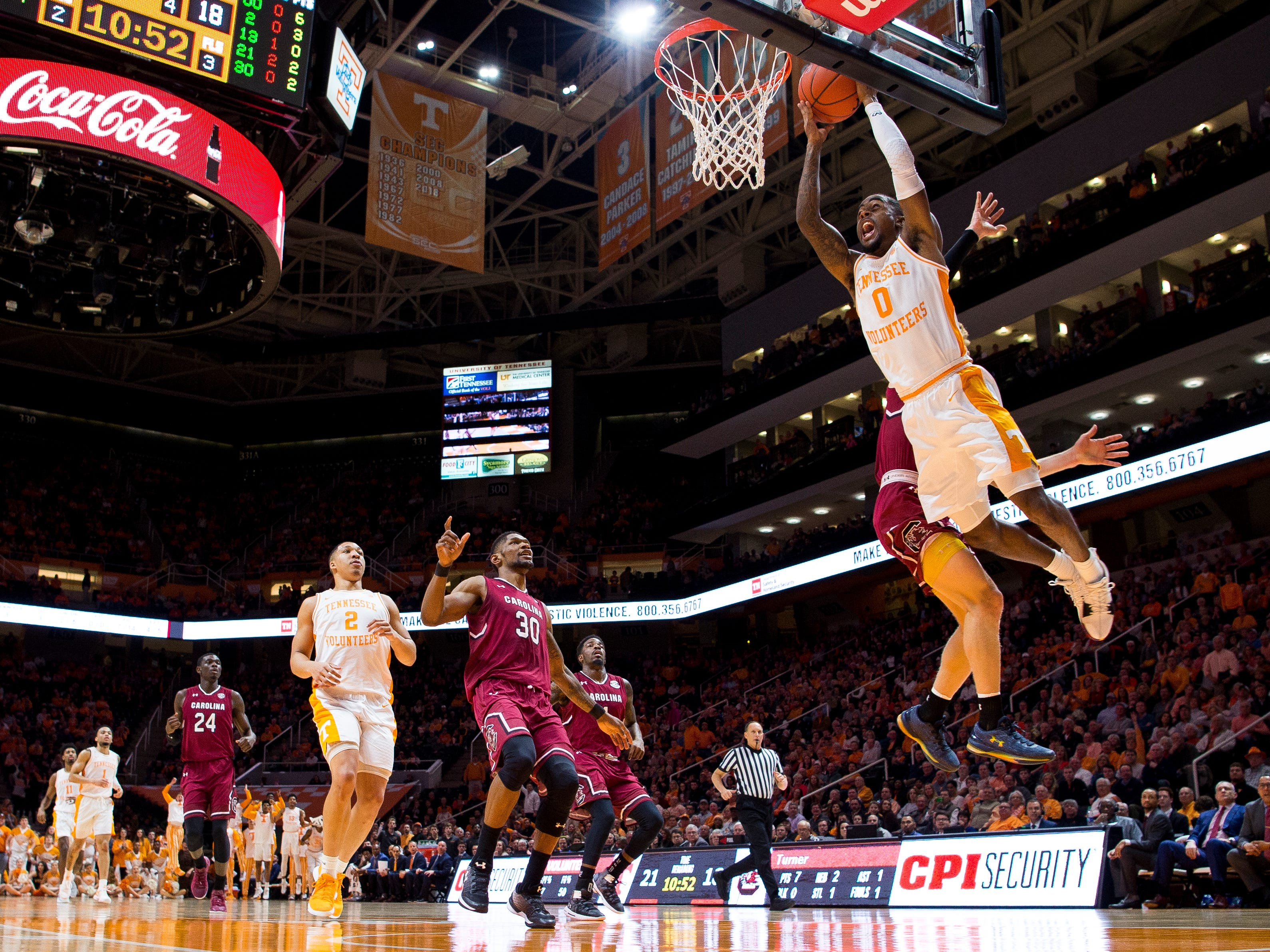 Tennessee guard Jordan Bone (0) is fouled and pushed out of bounds while attempting a dunk during Tennessee's home SEC game against South Carolina at Thompson-Boling Arena in Knoxville on Wednesday, February 13, 2019.