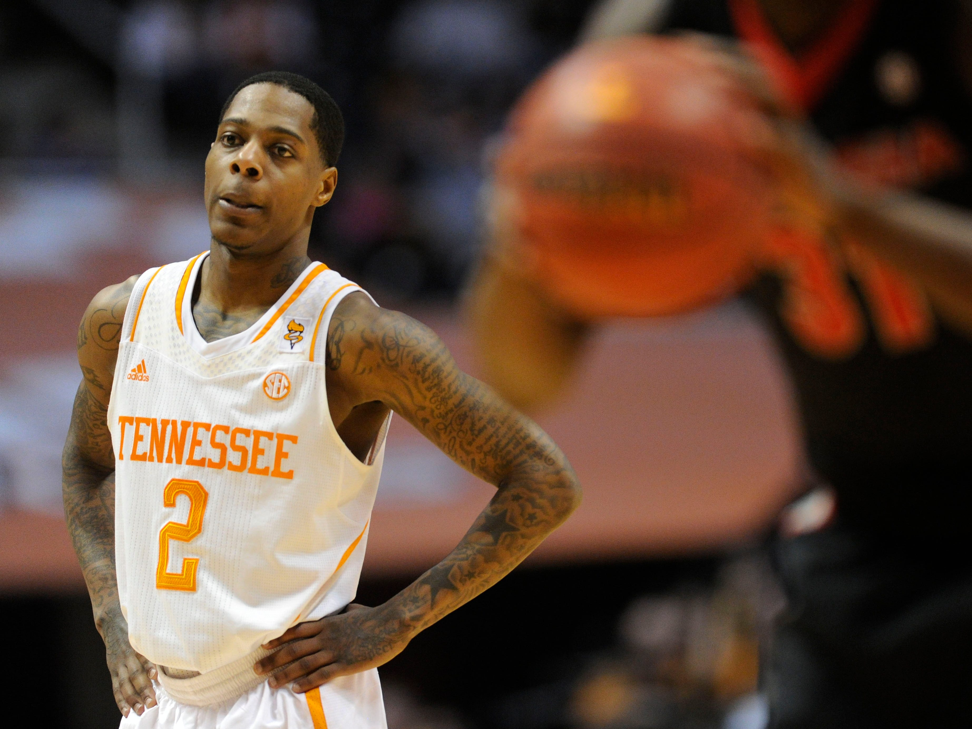 Tennessee guard Antonio Barton (2) looks on as Georgia shoots a free-throw during the second half at the Thompson-Boling Arena in Knoxville on Tuesday, Feb. 18, 2014. Tennessee defeated Georgia 67-48.