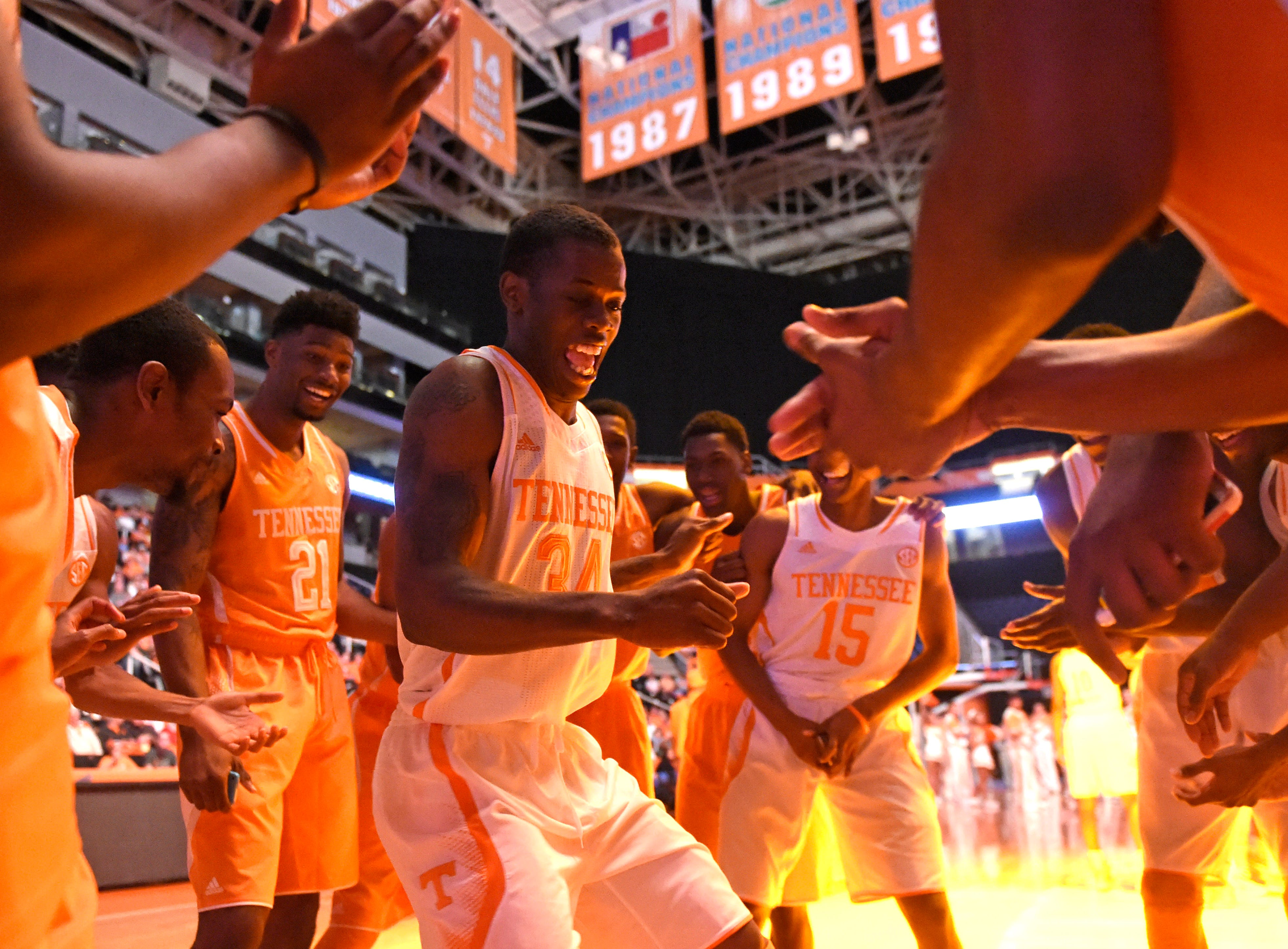 Tennessee basketball junior Devon Baulkman (34), center, dances in the huddle with teammates during Big Orange Madness at Thompson-Boling Arena on Friday, Oct. 24, 2014.