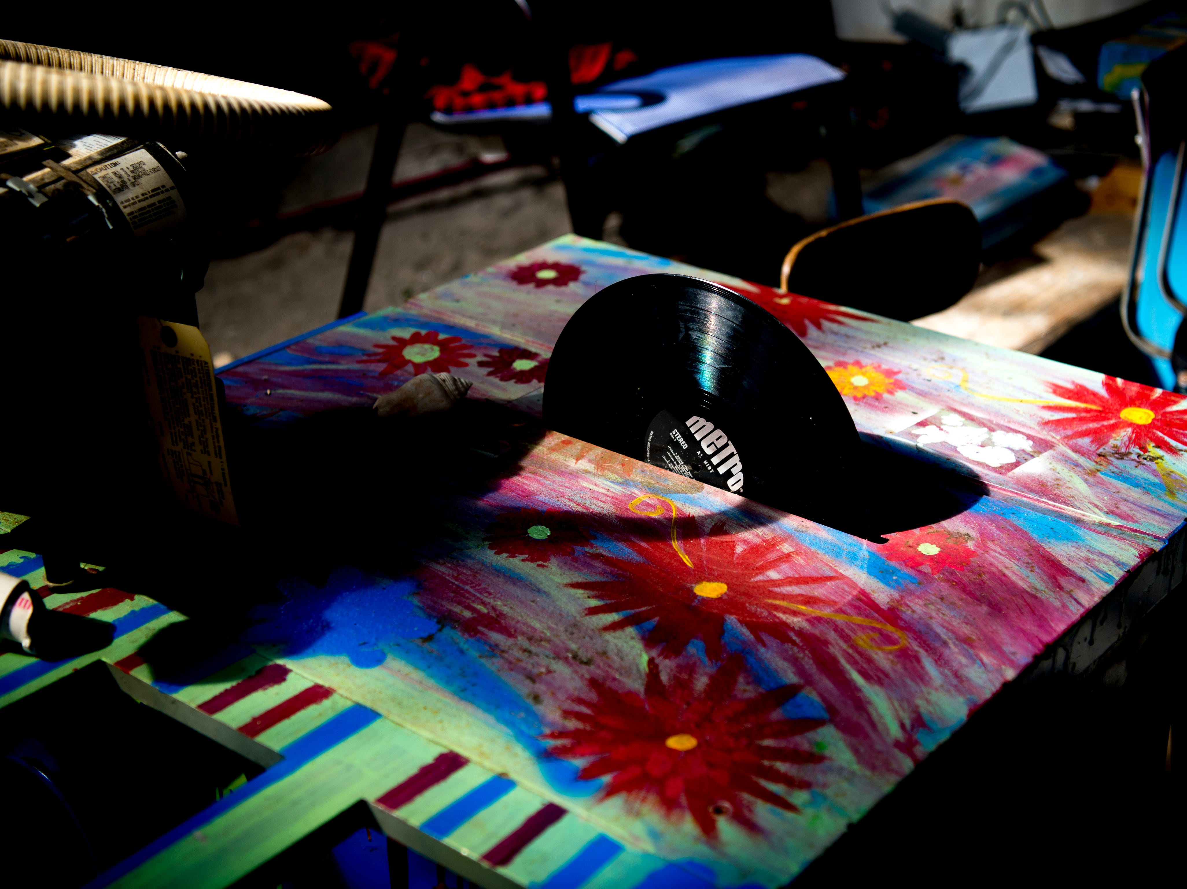 A cabinet saw is replaced with a vinyl record at Bar Marley in Knoxville, Tennessee on Thursday, February 14, 2019. The Caribbean-themed Bar Marley is facing possible acquisition and condemnation by KCDC due to code violations.