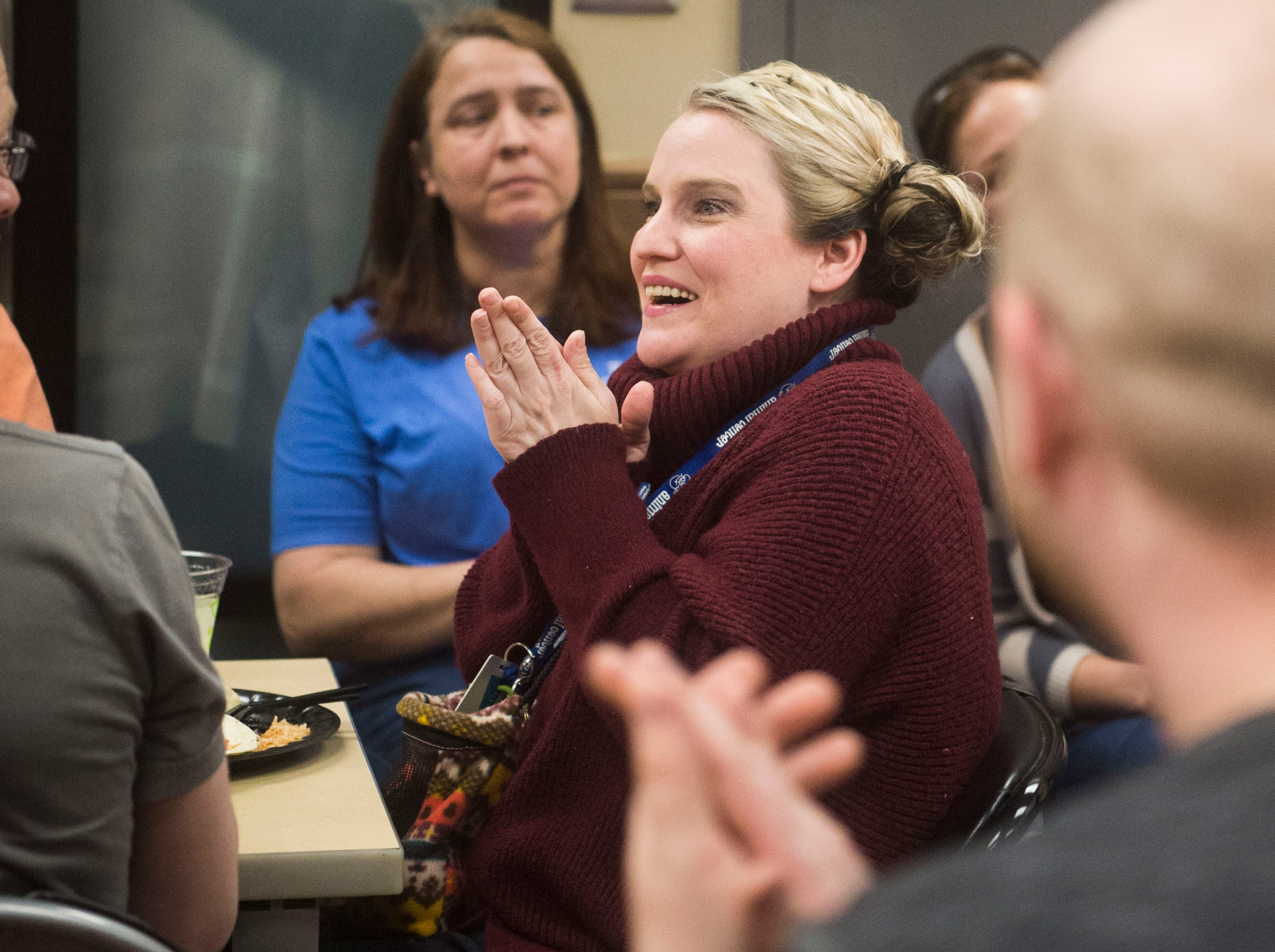 Tiffany Dawson, a pet resource coordinator at Young-Williams Animal Center in Knoxville, reacts to hearing the Petco Foundation donated a surprise $750,000 grant to the shelter, Thursday, Feb. 14, 2019.