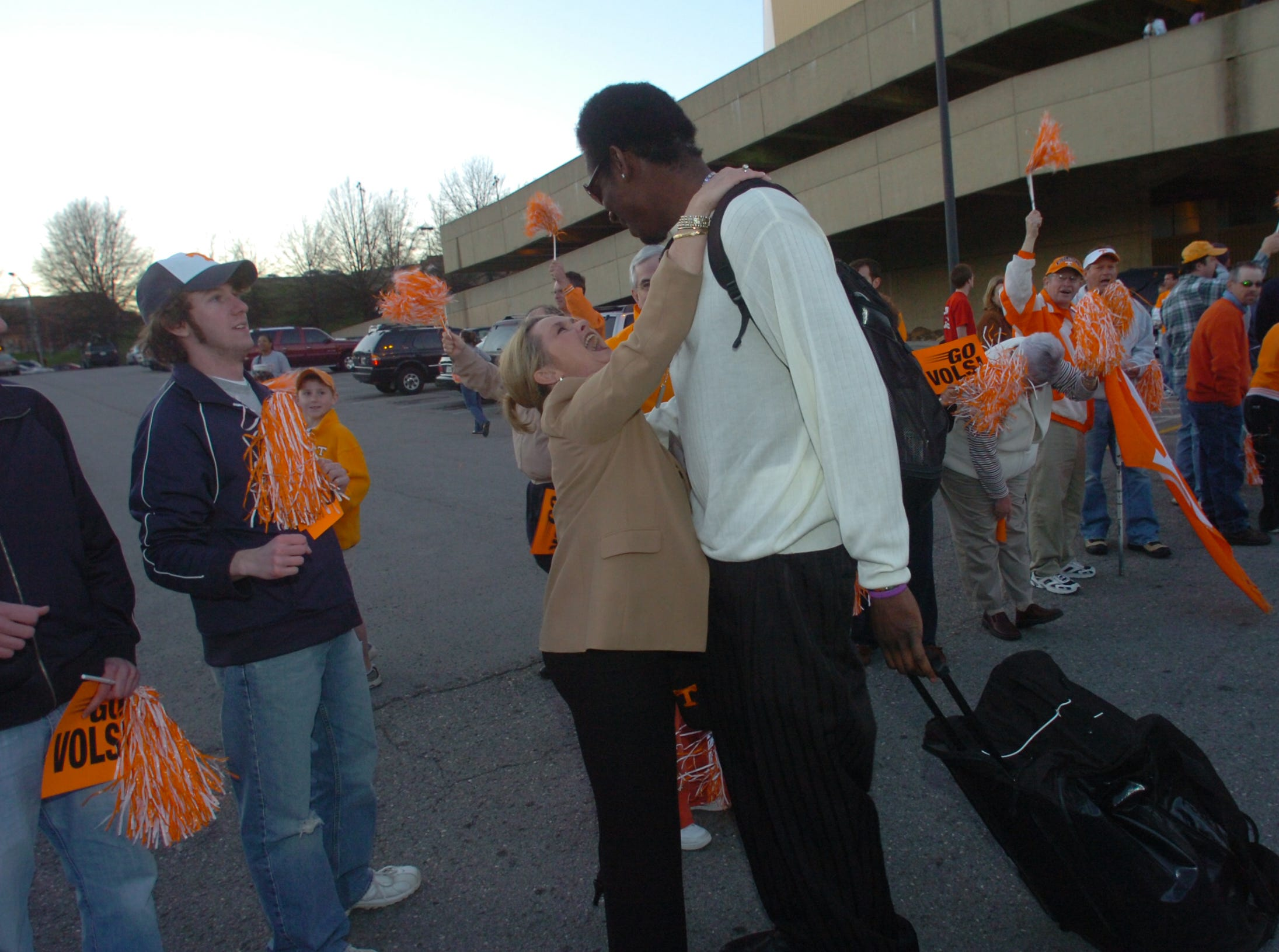 """Tennessee cheerleader's coach Joy Postell gives 6'10"""" center Major Wingate a hug during the men's basketball team's send off to the NCAA tournament Tuesday at Thompson-Boling Arena. The Vols will face Winthrop in a first-round game on Thursday in Greensboro, N.C.   3/14/2006"""