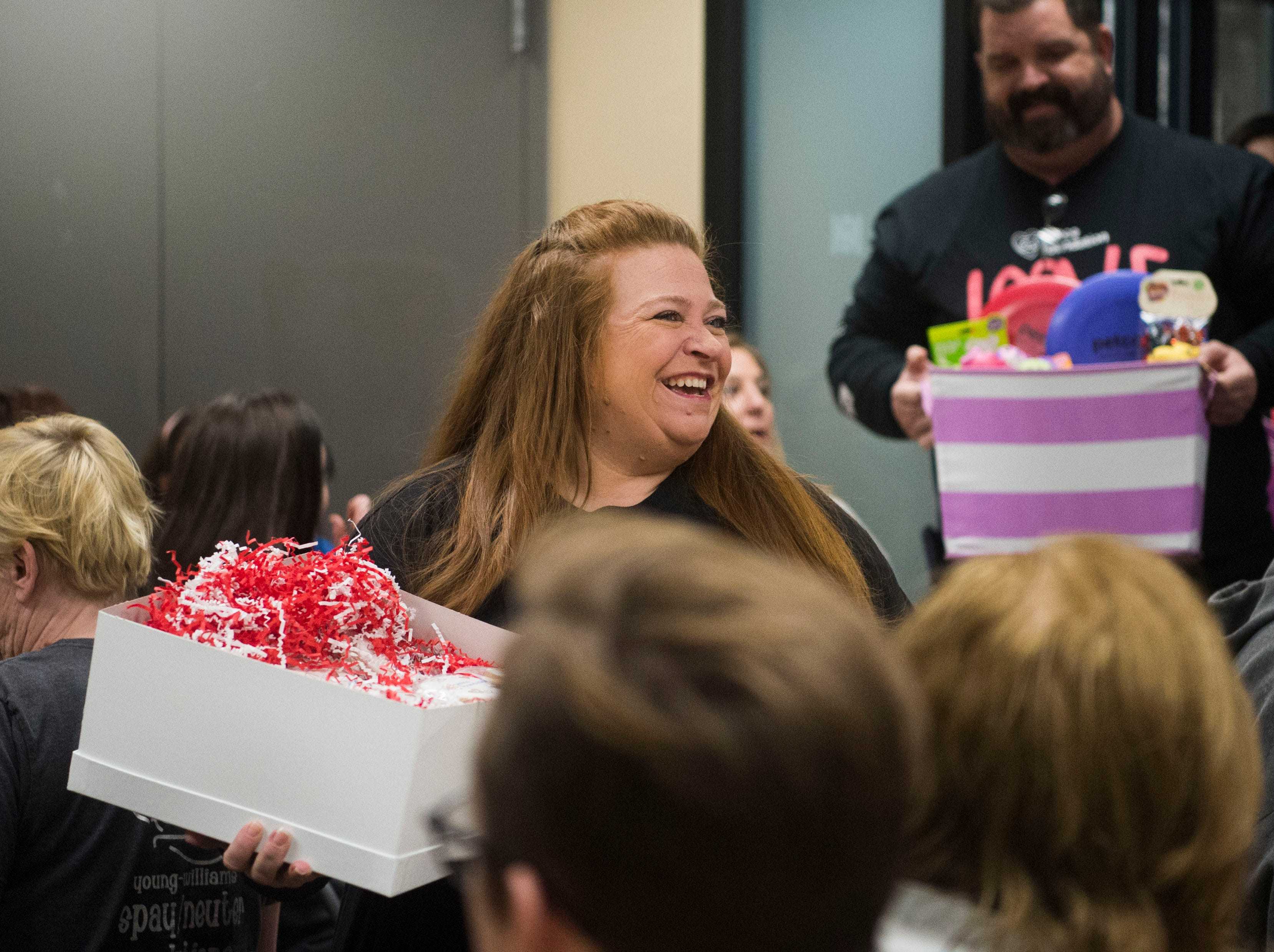 Wendy Fontaine, regional field program manager for the Petco Foundation, walks into a room of unexpecting employees at Young-Williams Animal Center in Knoxville Thursday, Feb. 14, 2019. The animal shelter received a surprise $750,000 grant from the Petco Foundation.Ê