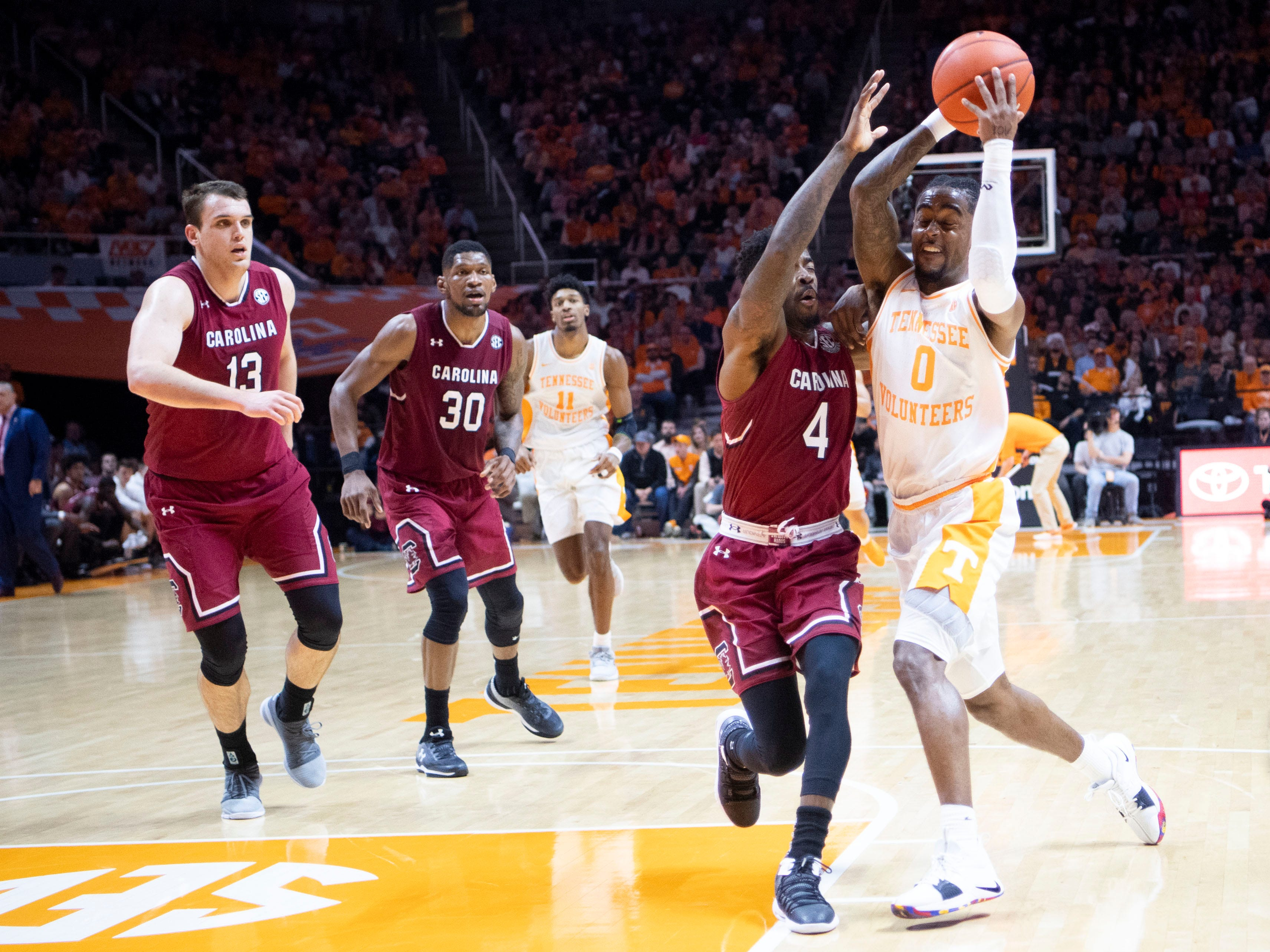 Tennessee's Jordan Bone (0) drives towards the basket while guarded by South Carolina's Tre Campbell (4) on Wednesday, February 13, 2019.