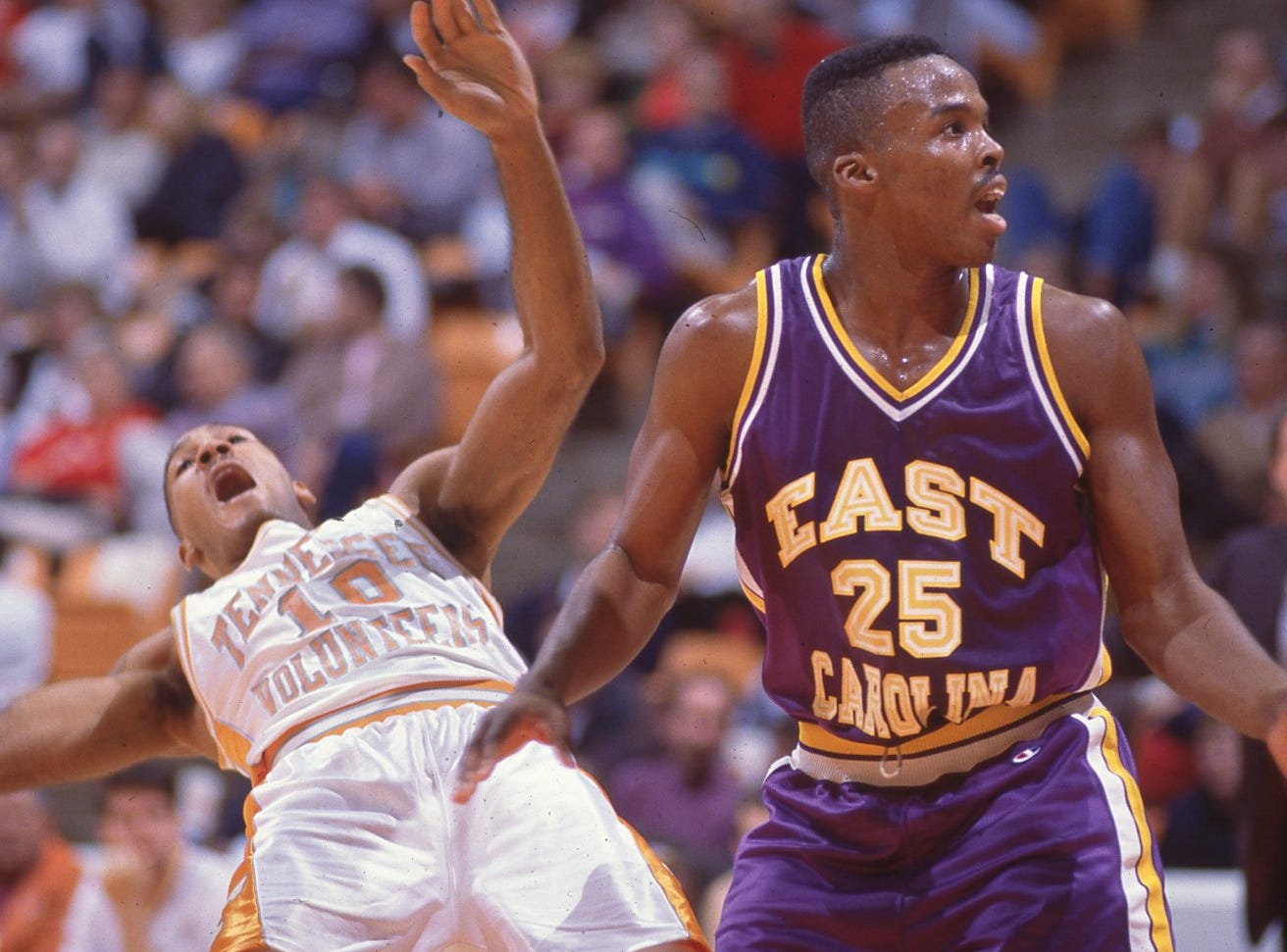 Tennessee's Jay Price (10) uses elaborate drama to try to get a foul call out of the referee as East Carolina's Ronnell Patterson also looks toward the referee questioning what he did in December 1991. Peterson won the dramatics and was not called for a foul.