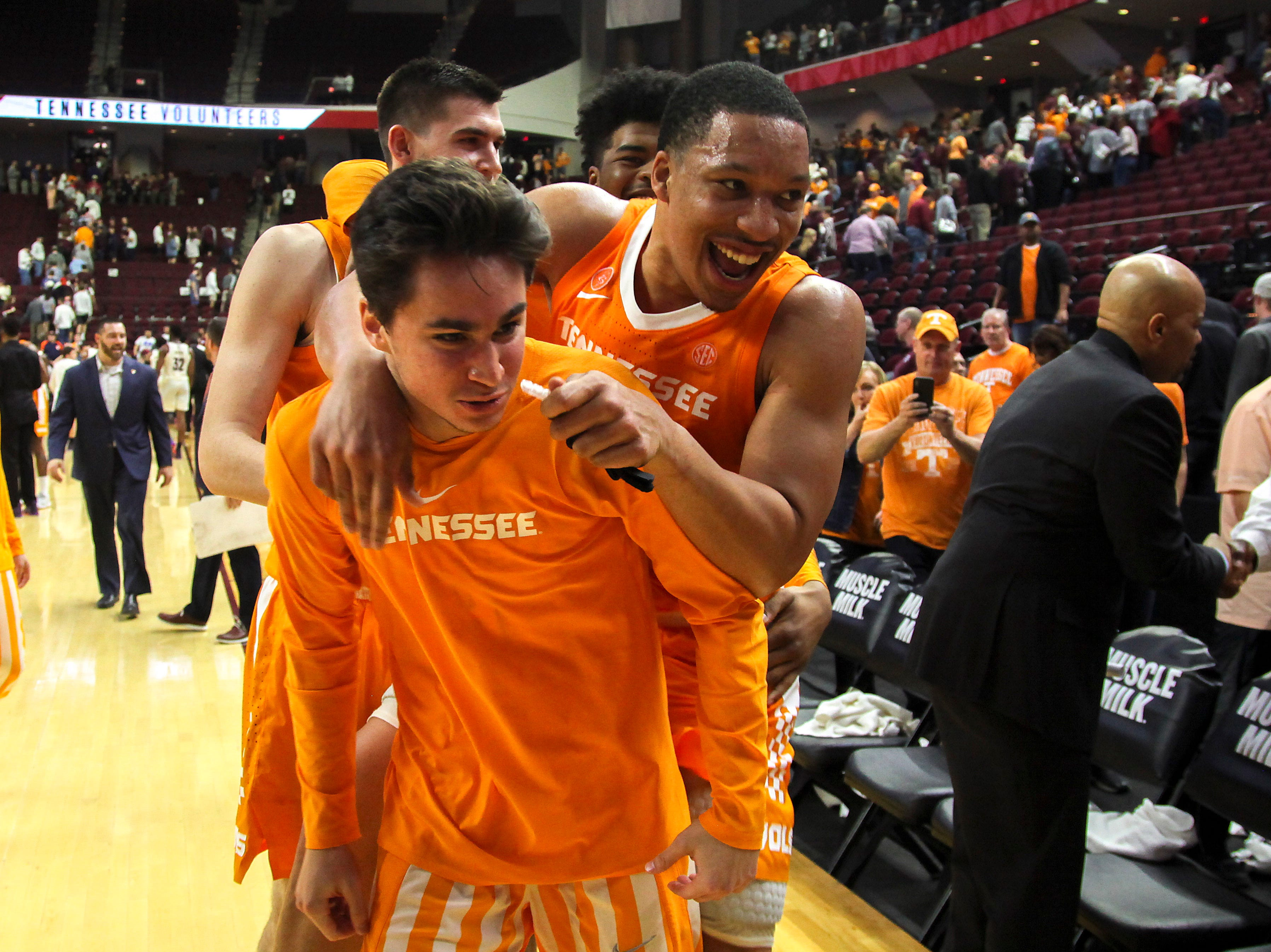 Feb 2, 2019; College Station, TX, USA; Tennessee Volunteers guard Jacob Fleschman (4) and forward Grant Williams (2) celebrate after the Volunteers defeat the Texas A&M Aggies at Reed Arena.