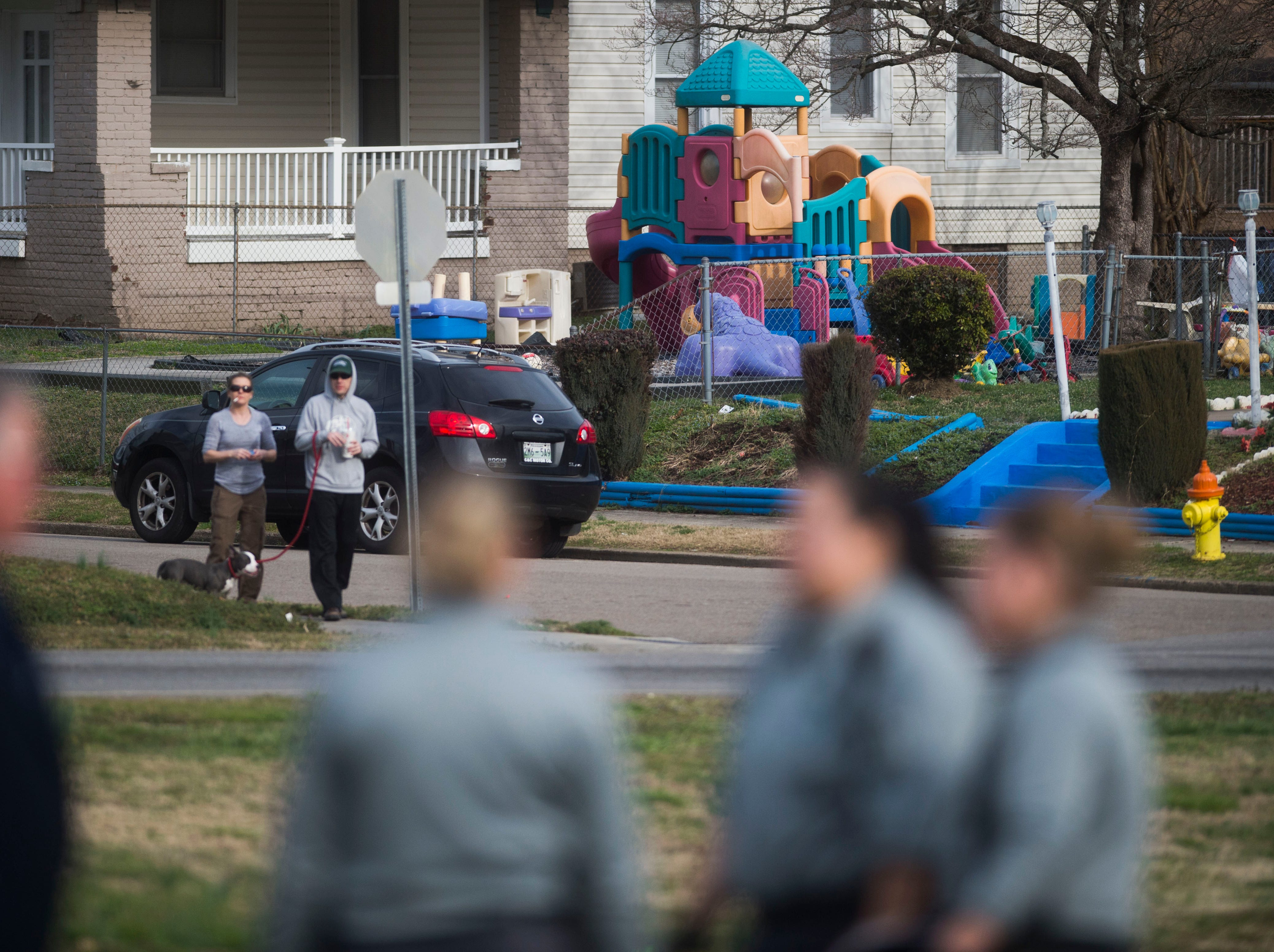 A child care facility is seen in the background as the Knoxville Police Department investigates a shooting near the Pilot gas station on East Magnolia in East Knoxville, Thursday, Feb. 14, 2019. One man was shot and the suspect is in custody.