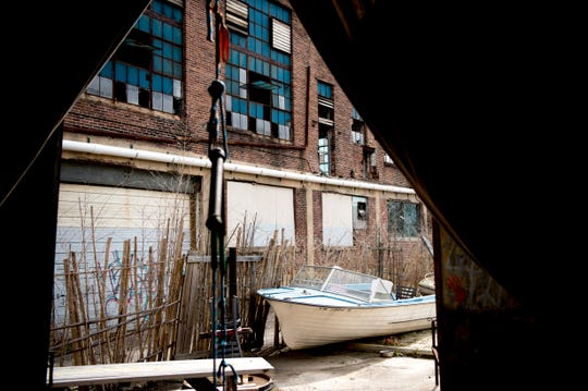 An old boat and a wooden fence give a Caribbean feel to the courtyard at Bar Marley in Knoxville, Tennessee on Thursday, February 14, 2019. The Caribbean-themed Bar Marley is facing possible acquisition and condemnation by KCDC due to code violations.