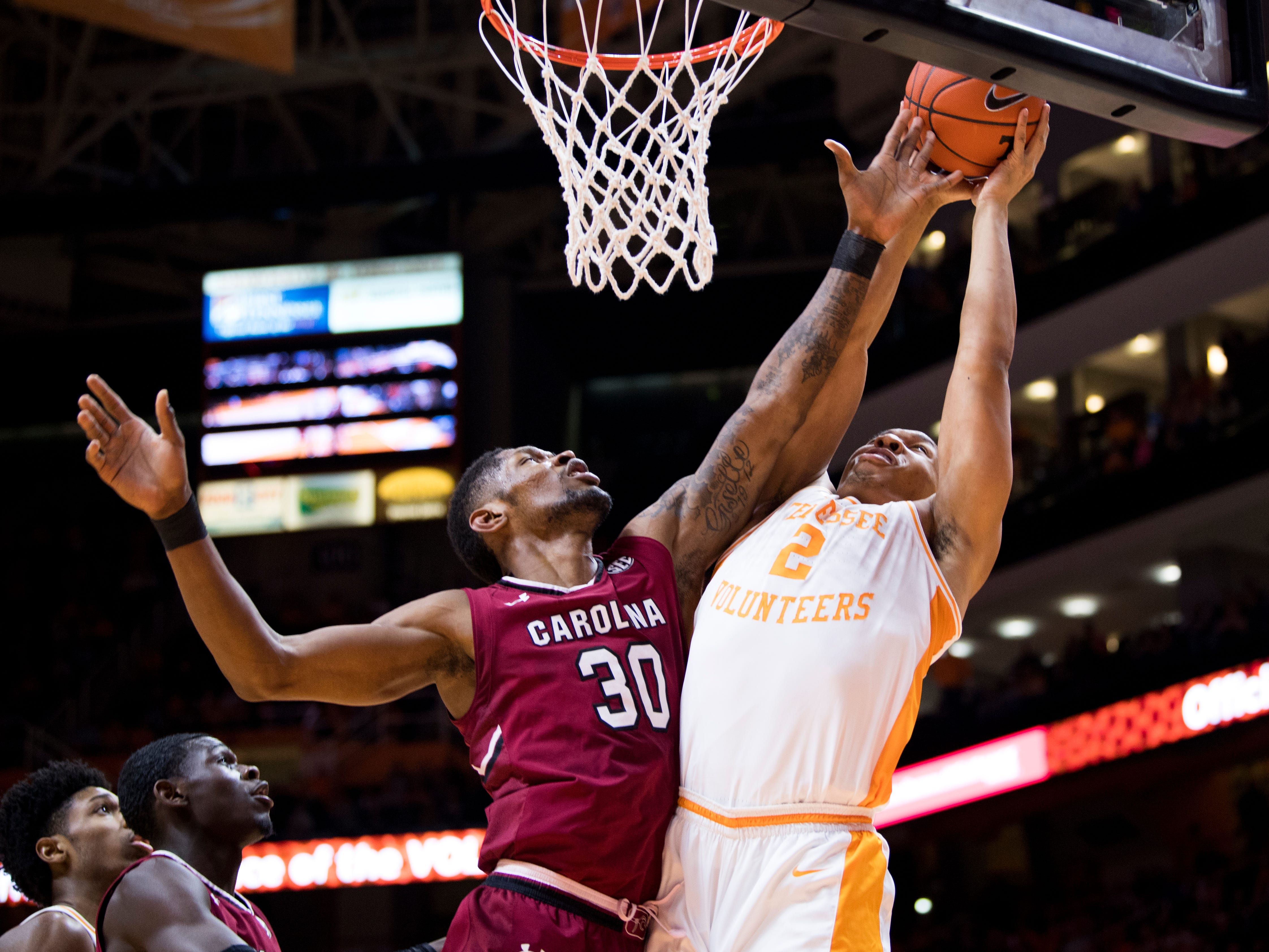 Tennessee forward Grant Williams (2) attempts a shot past South Carolina forward Chris Silva (30) during Tennessee's home SEC game against South Carolina at Thompson-Boling Arena in Knoxville on Wednesday, February 13, 2019.