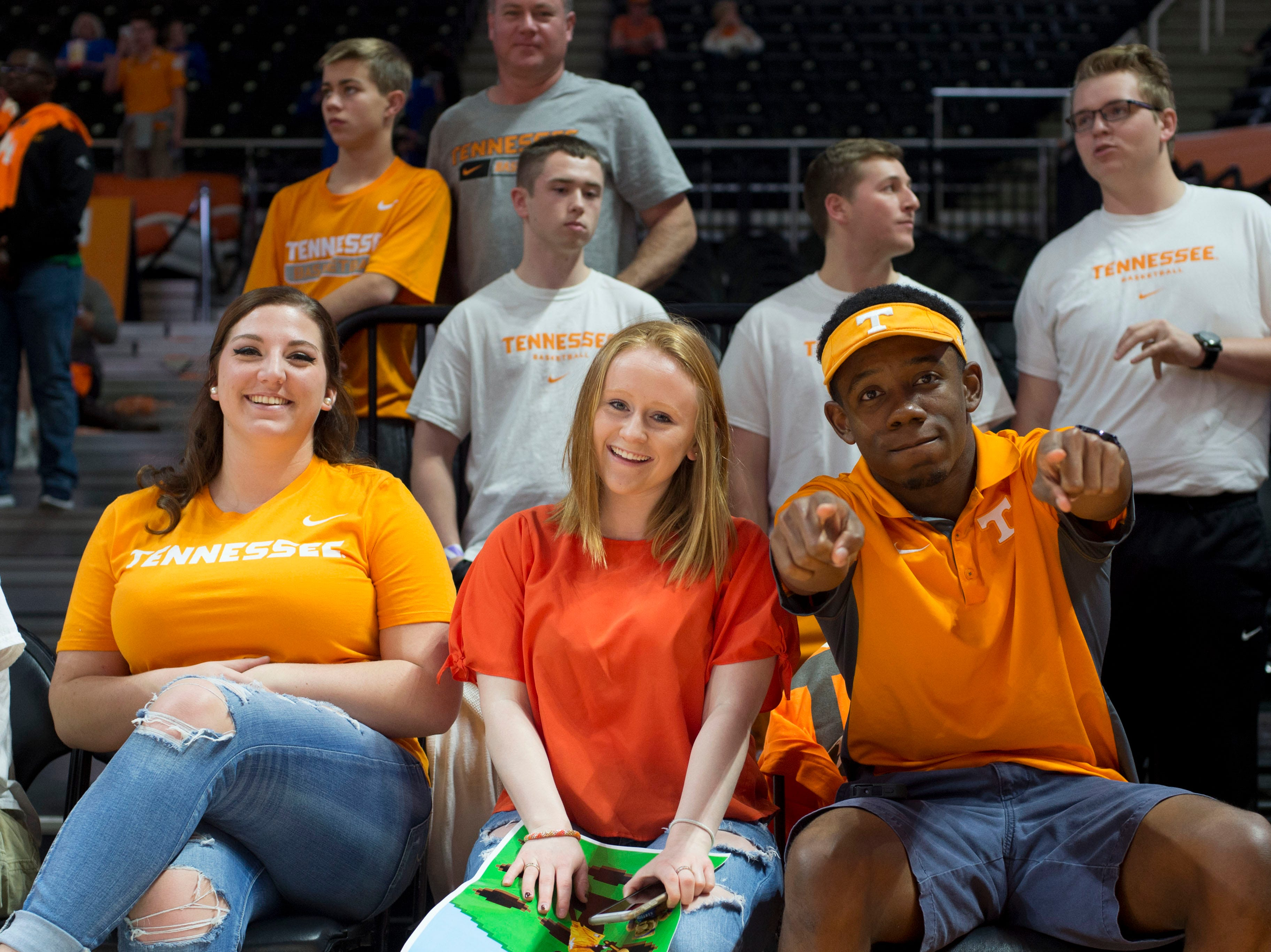 Tennessee fans, from left, Olivia Grant, Alyssa Frohock, and Trennie Williams with courtside seats the Tennessee and Kentucky basketball game in Thompson-Boling Arena on Tuesday, February 2, 2016.