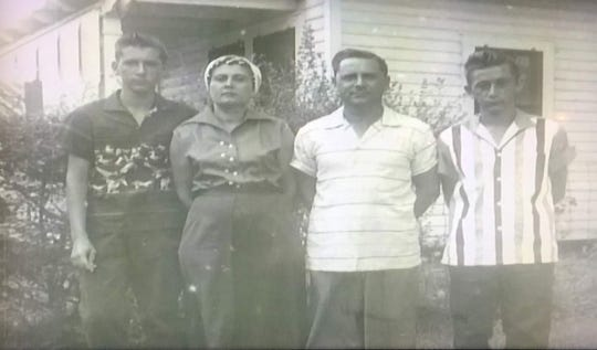 Robert, Gladys, Wallace and John Wilbert Menard outside of the home in Judice, Louisiana.