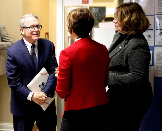 Gov. Mike DeWine, left, listens with Jennifer Walters, center, president of Fairfield Homes, and Kellie Ailies, executive director of Lancaster-Fairfield Community Action Agency, as they tell him about the Head Start room at the Pearl House. DeWine toured the sober living apartment complex Wednesday, Feb. 13, 2019, in downtown Lancaster.