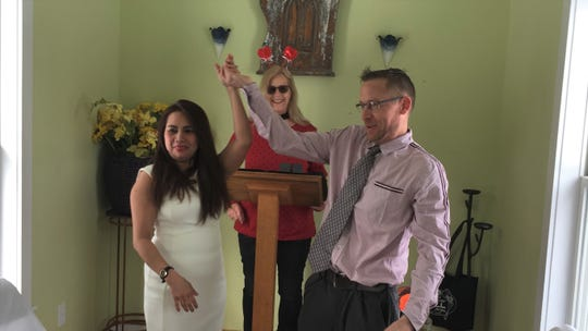 Newlyweds Maricel and David Riopelle celebrate their Valentine's Day wedding in Hell, Thursday, Feb. 14, 2019. Officiant Dana Moore celebrates with them in Hell's Chapel of Love.