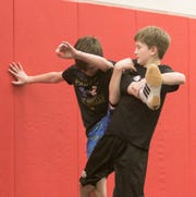 Levi Podhola, right, wrestles teammate Owen O'Sullivan in a practice Wednesday, Feb. 13, 2019.