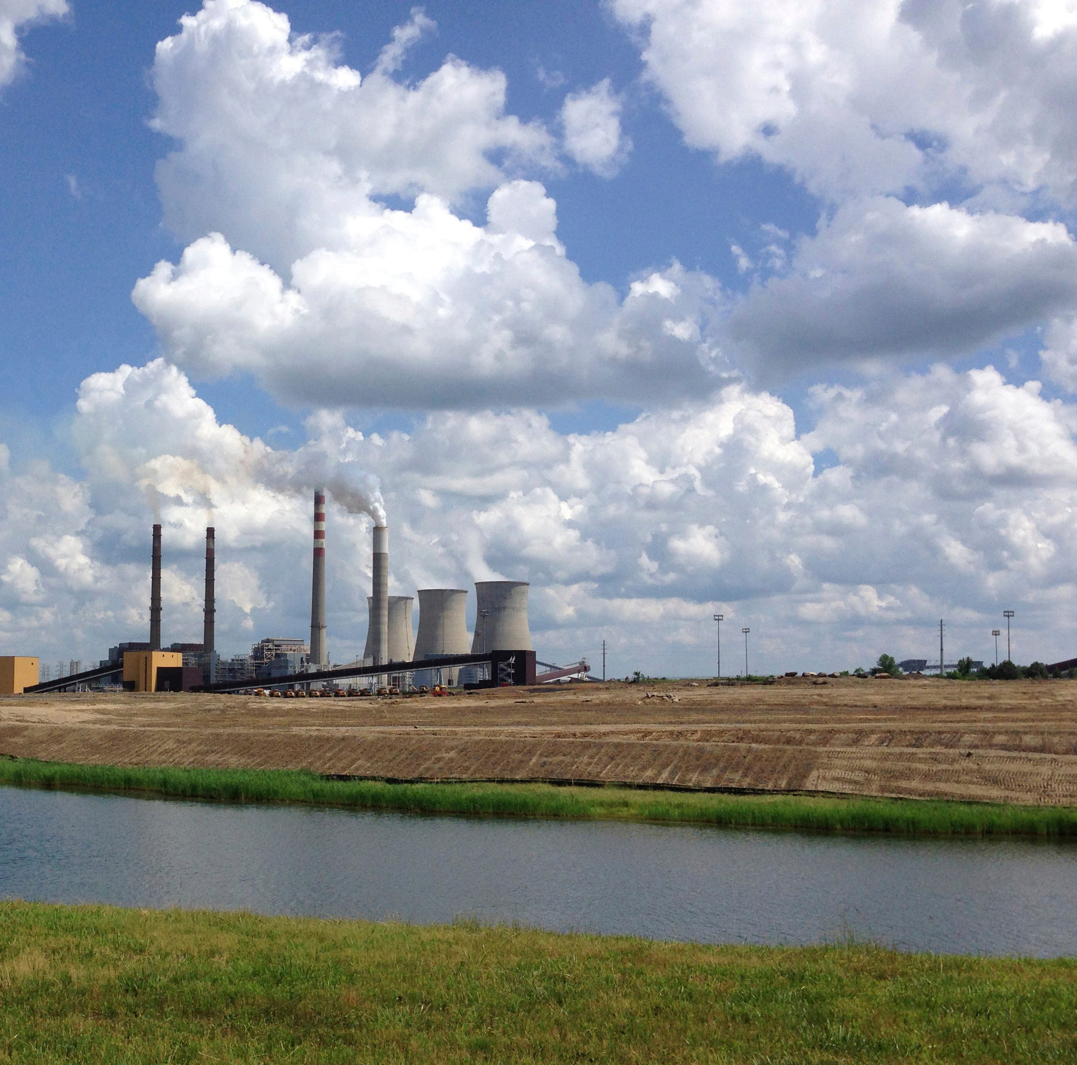 FILE - This June 3, 2014, file photo shows a panoramic view of the Paradise Fossil Plant in Drakesboro Ky. President Donald Trump's vow to save the coal industry will be tested this week when a utility board he appoints weighs whether to close a coal-fired power plant in Kentucky whose suppliers include a mine owned by one of his campaign donors. An environmental assessment by the Tennessee Valley Authority recommends shuttering the remaining coal-fired unit at the Paradise Fossil Plant in Muhlenberg County. The board could vote on Thursday, Feb. 14, 2019. (AP Photo/Dylan Lovan, File)
