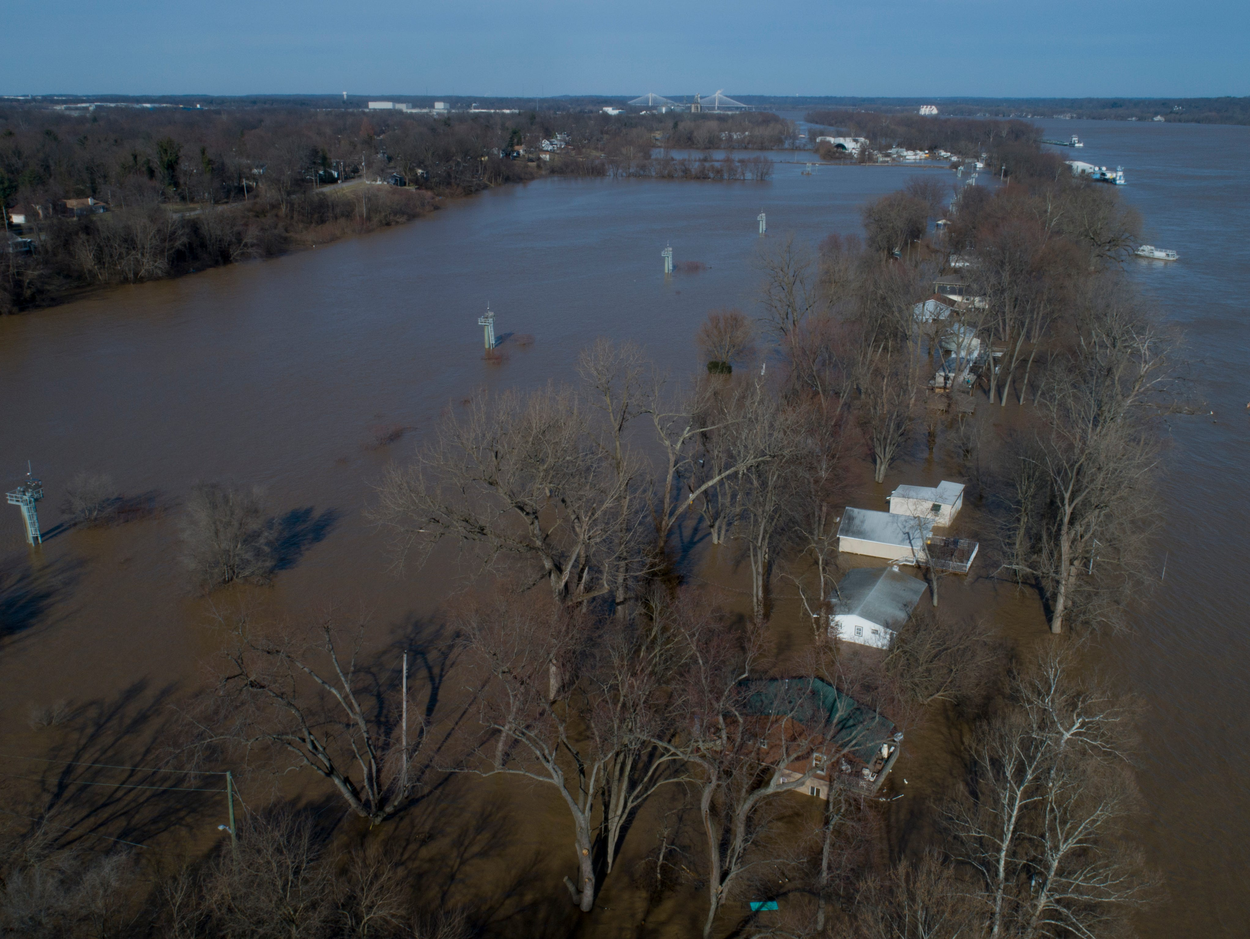 Flood waters surround the homes on Utica Pike on Wednesday afternoon. Feb. 13, 2019