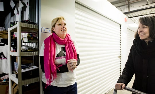 Lysne Tait, left, of DeWitt, talks about the how the organization Helping Women Period has grown, Wednesday, Feb. 13, 2019, at a storage unit in Lansing's Old Town, where the group stores feminine hygiene products. Also pictured is volunteer Toni Colagross, right, of Delta Township.