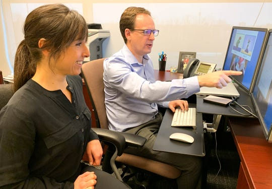 Researchers Derek Houston (right) and Claire Monroy review data after conducting the first study to examine cognitive development in deaf infants. The study found that developmental differences begin very early in life for deaf children and extend far beyond the auditory system.