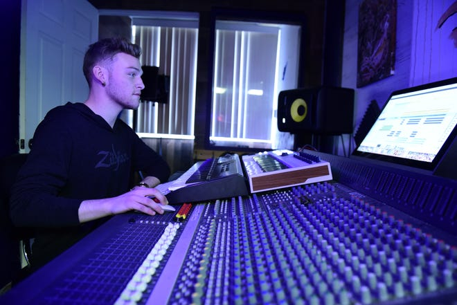 Ethan Ritenour mixes a track inside DayTrip Studios downtown Mansfield.