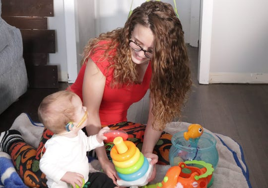 Macey Kinney plays with her 10-month-old son, Zealand, who was born deaf. A new study shows that developmental differences in deaf babies extend beyond language and hearing, and begin surprisingly early in life.