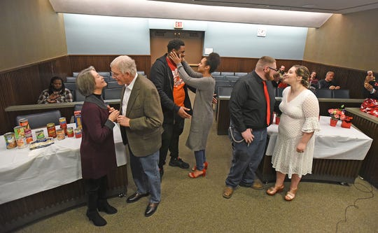 Newlyweds Richard Remington and Margie Taylor, Nathan Feagin Jr. and Kiauna Lattimore and Jeremy Scanlon and Arionna Elliott kiss after they wed Thursday afternoon in Mansfield Municipal Court Judge Frank Ardis' courtroom.