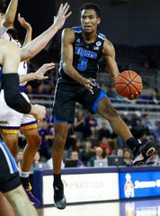 Memphis guard Jeremiah Martin makes a pass around the ECU defense during action in Greenville, N.C. Wednesday, February 13, 2019.
