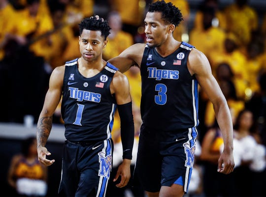 Memphis teammates Tyler Harris and Jeremiah Martin walk-off the court during a break in action against ECU in Greenville, N.C. Wednesday, February 13, 2019.