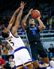 Memphis guard Jeremiah Martin (right) is fouled by ECU defender Tyler Foster (left) while driving to the basket during action in Greenville, N.C. Wednesday, February 13, 2019.