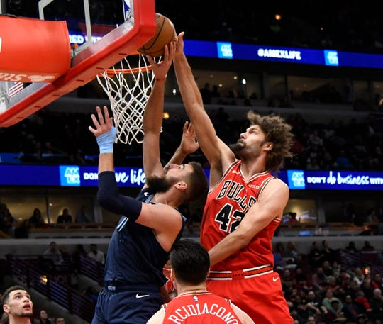 Chicago Bulls center Robin Lopez (42) blocks the shot of Memphis Grizzlies center Jonas Valanciunas (17) during the first half of an NBA basketball game, Wednesday, Feb. 13, 2019, in Chicago. (AP Photo/David Banks)