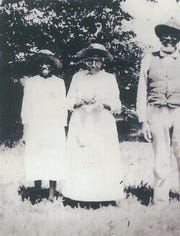 In the early 1900s, George Singleton with his wife, Barbara, middle, and third family member.