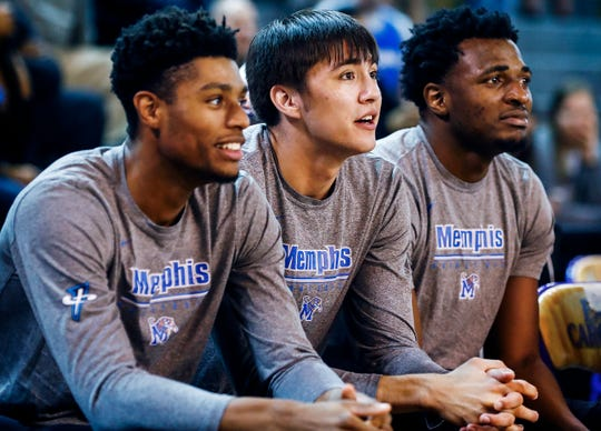 Memphis teammates (left to right) Ryan Boyce, David Wingett and Victor Enoh watch the final minutes of a Tigers 79-69 victory over ECU in Greenville, N.C. Wednesday, February 13, 2019.
