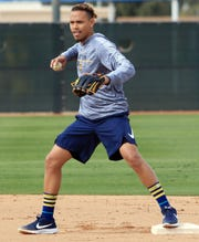 Shortstop Orlando Arcia gets ready to throw to first during infield drills on the first day of the Brewers' spring training workouts on Wednesday in Phoenix.