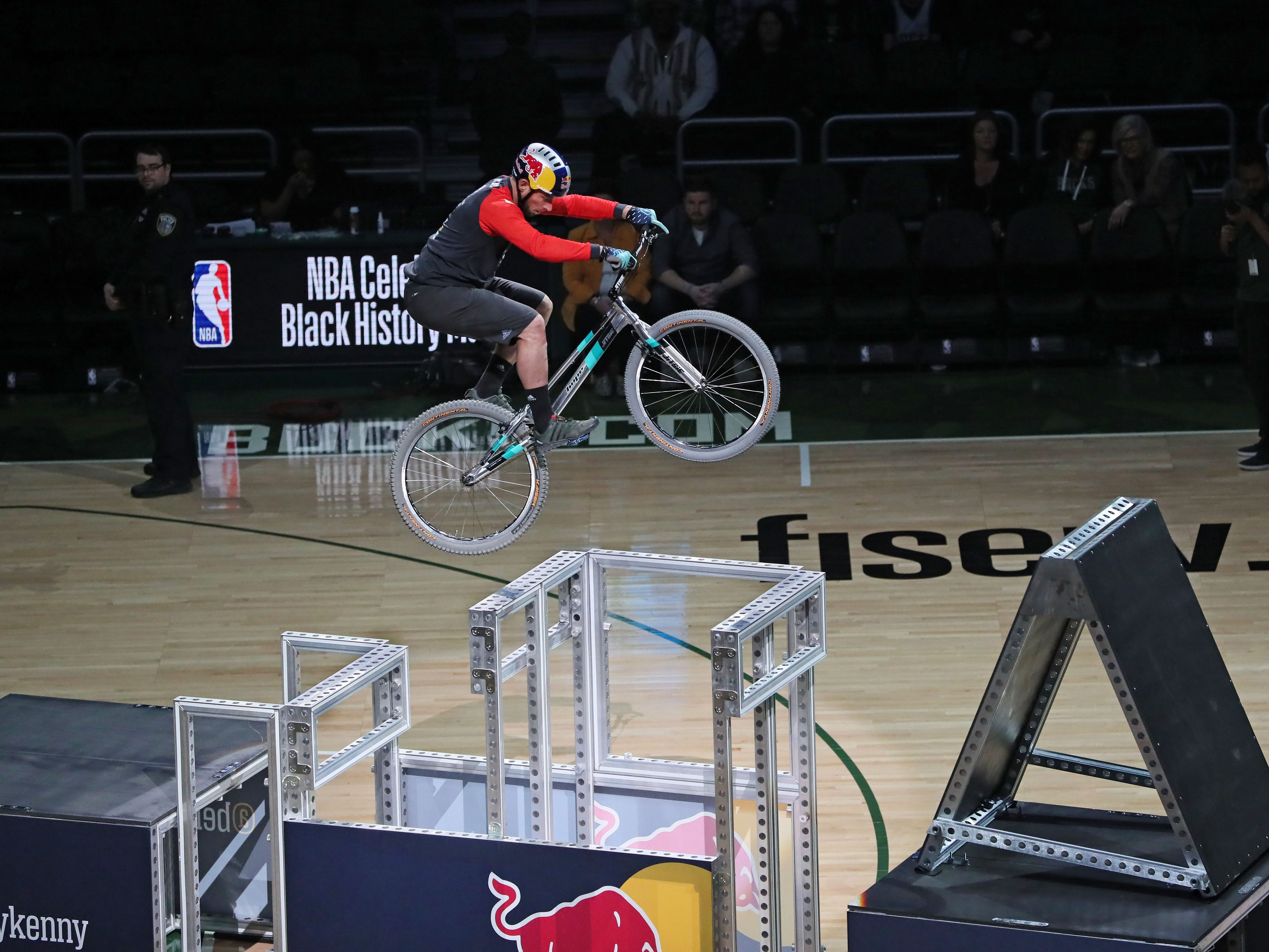 Kenny Belaey of Belgium, a champion mountain bike trials rider, hops from obstacle to obstacle using just his soft-tired bike, muscle and balance to make the leaps. Trials riding is all about moving over obstacles on your bike without your feet touching ground.  He performed during halftime on Feb. 6.
