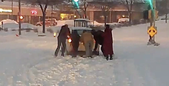 An MCTS bus driver and several riders helped push a car that was stuck on train tracks.