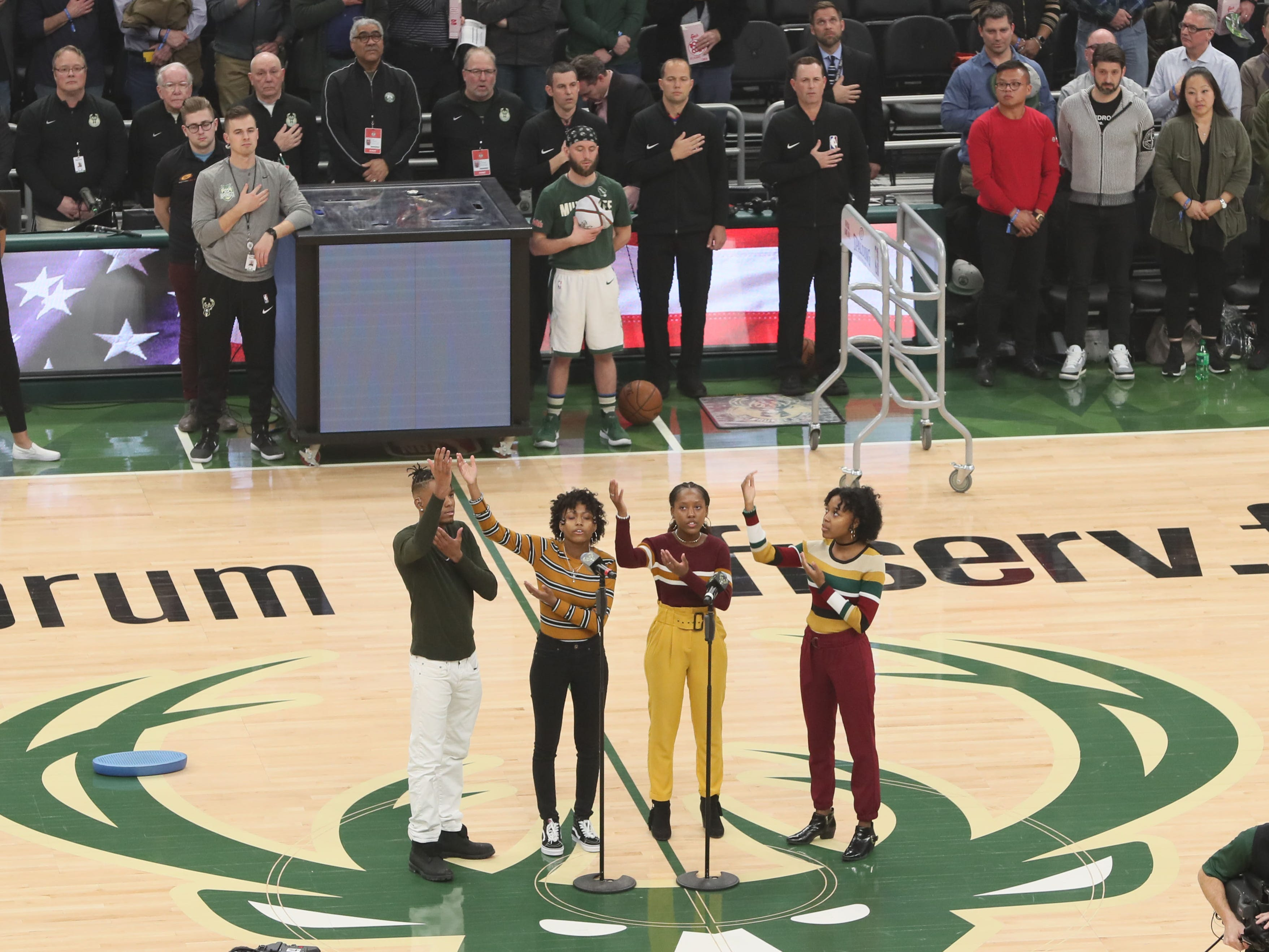 Members of Signs and Voices sing the national anthem while signing it as well Feb. 6.