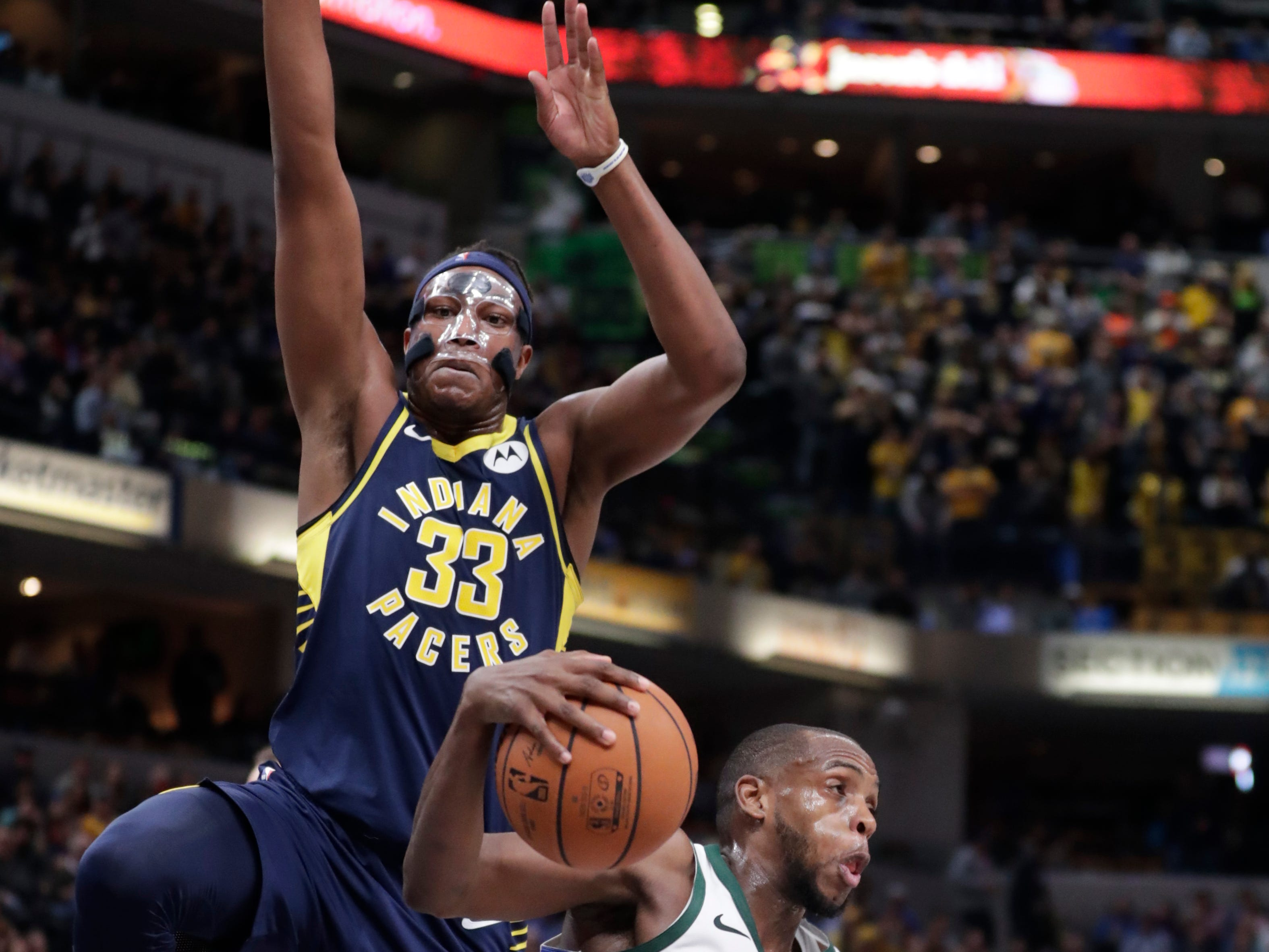 Bucks forward Khris Middleton gets Pacers center Myles Turner up in teh air with a ball fake during the second half Wednesday.