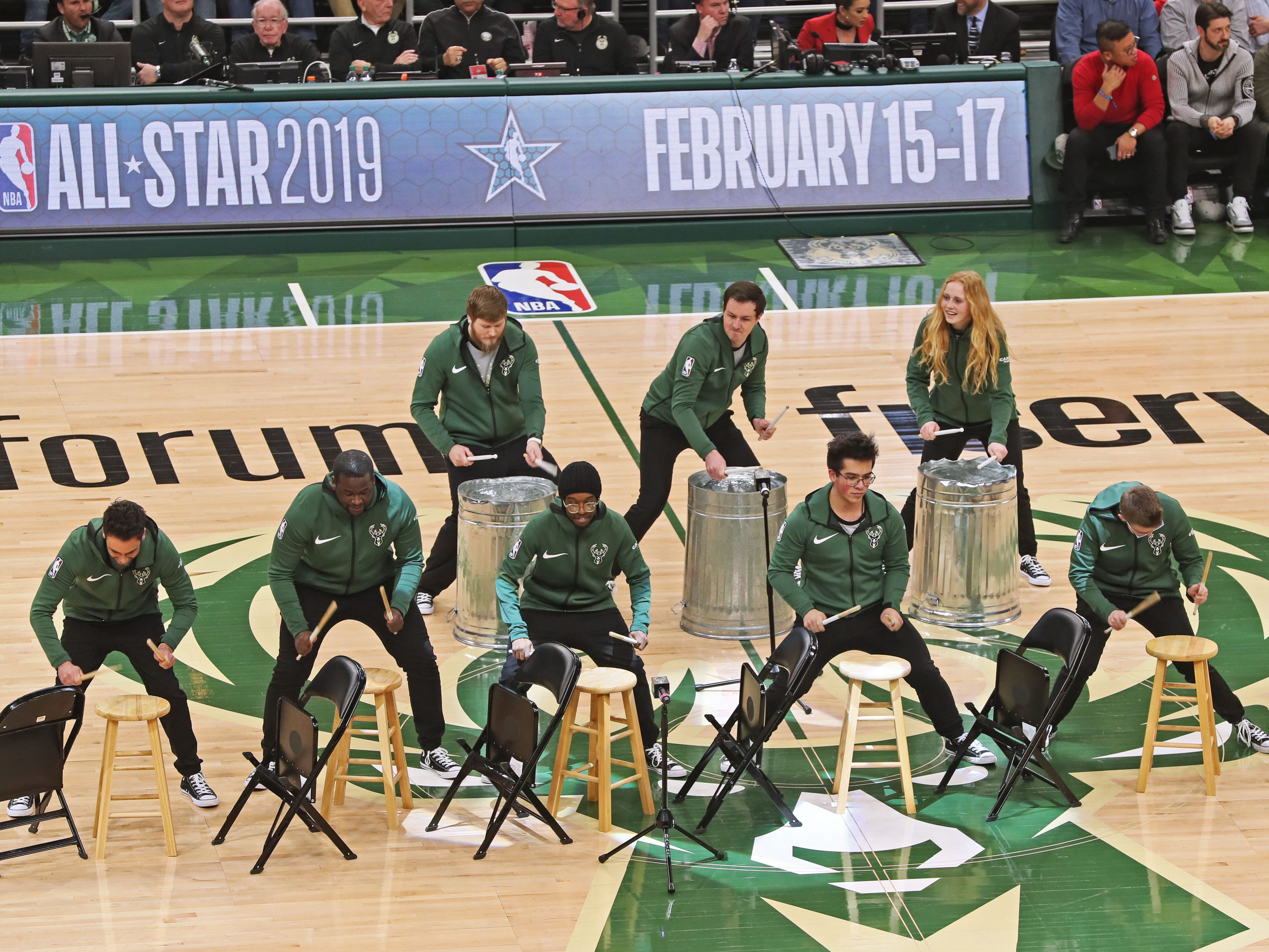Members of the Bucks Beats presented by Cascio Music drum on stools and trash cans.