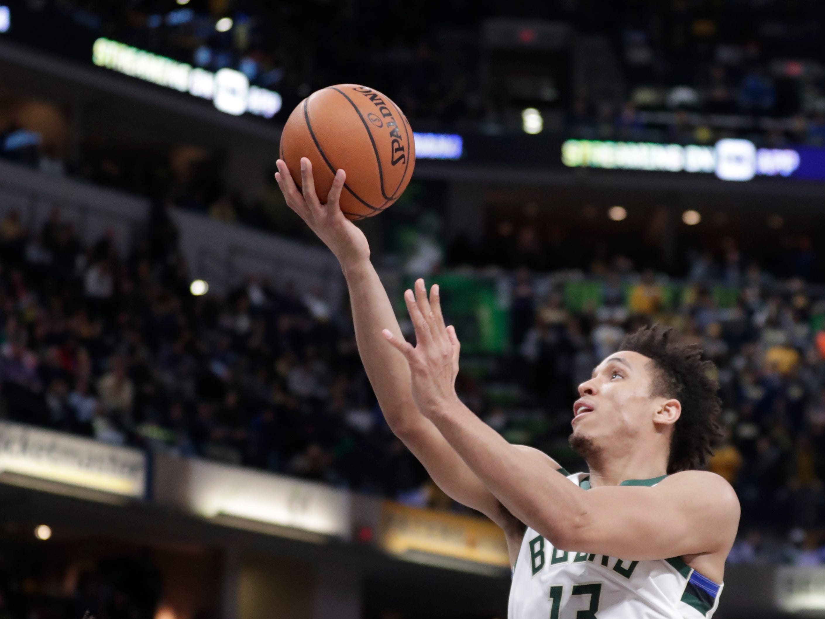 Milwaukee Bucks guard Malcolm Brogdon is fouled by Pacers guard Wesley Matthews on a drive to the basket during the second half Wednesday night.