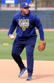 First baseman Jesus Aguilar takes infield practice on the first day of Brewers' spring training workouts on Wednesday in Phoenix.