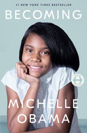 A Milwaukee student re-creates Michelle Obama's book cover.