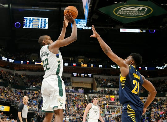 Bucks forward Khris Middleton cans a big three-pointer over Pacers forward Thaddeus Young late in the fourth quarter Wednesday night.
