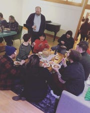 Guests gathered at Buttonhill Studios in Mineral Point to enjoy a multi-course Filipino dinner, cooked by Leslie Damaso (in red sweater) and Eve Studnicka.